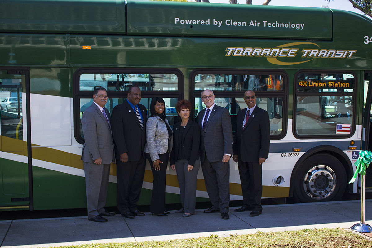 City Council Standing in front of a Torrance Transit Bus